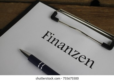 Finanzen (german for financial) clipboard close up with a pen