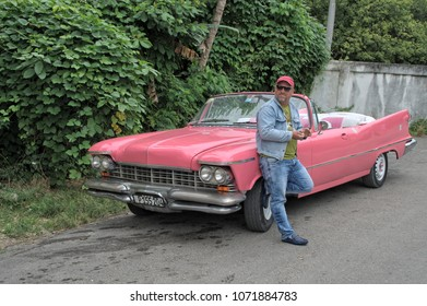 FINCA VIGIA, CUBA - January 4, 2018: The taxi driver waiting for tourists at a vintage classic car.