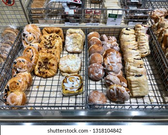 FINCHLEY ROAD, LONDON - FEBRUARY 20, 2019: Sugar coated sweet and sticky baked goods on sale in the bakery section at Waitrose Supermarket on the Finchley Road, North London, UK.