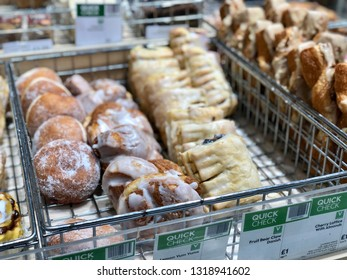 FINCHLEY ROAD, LONDON - FEBRUARY 20, 2019: Unhealthy baked treats on sale at Waitrose supermarket on the Finchley Road, North London, UK.