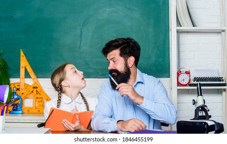 Find buddy to help you study. Private lesson. School teacher and schoolgirl. Pedagogue skills. Talented pedagogue. Work together to accomplish more. Man bearded pedagogue. Homeschooling with father.