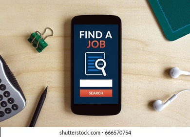 Find a job concept on smart phone screen on wooden desk. Flat lay