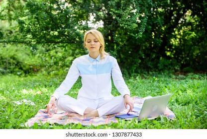 Find minute to relax. Clear your mind. Girl meditate on rug green grass meadow nature background. Every day meditation. Woman relaxing practicing meditation. Reasons you should meditate every day.