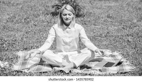 Find minute to relax. Woman relaxing practicing meditation. Every day meditation. Reasons you should meditate every day. Clear your mind. Girl meditate on rug green grass meadow nature background.