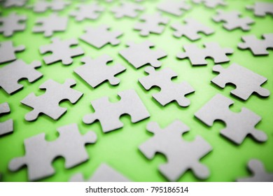 Find solution, jigsaw puzzle parts on green background
