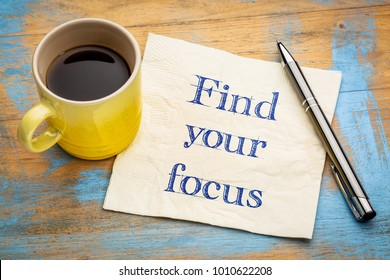 Find your focus - handwriting on a napkin with a cup of espresso coffee
