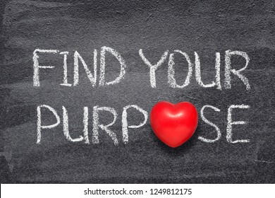 find your purpose phrase handwritten on chalkboard with red heart symbol instead of O