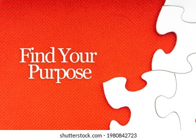 FIND YOUR PURPOSE text with jigsaw puzzle on red background. Business and Motivation Concept