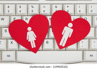 Finding love on the Internet, A close-up of a keyboard with two red hearts with a man and a woman