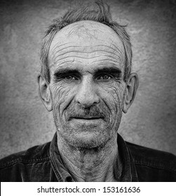 Fine ar photo of elderly bald man with wrinkled face and mustaches, grungy  background