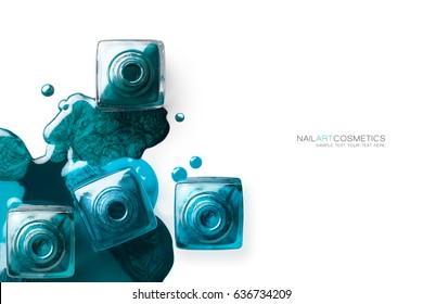 Fine art beauty concept of nail polish with bluish green and metallic aquamarine nail lacquer artistically spilled around four open bottles viewed from overhead isolated on white with copy space