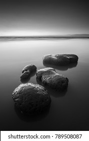 Fine art black & white image of stepping stones near the beach in Pulau Pinang island Malaysia. Soft focus due to long exposure.