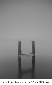Fine Art black and white photo of a broken pier