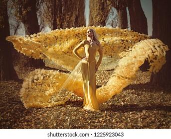 Fine art image. Beautiful blonde beauty in an autumn scenery