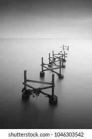 Fine art image in black & white of abandon jetty at Port DIckson, Malaysia. Soft Focus due to long exposure.