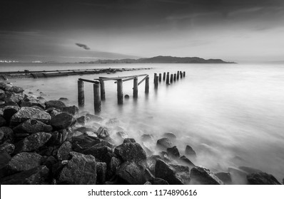 Fine art image in black & white of abandon jetty at Pulau Pinang island, Malaysia. Soft Focus due to long exposure.