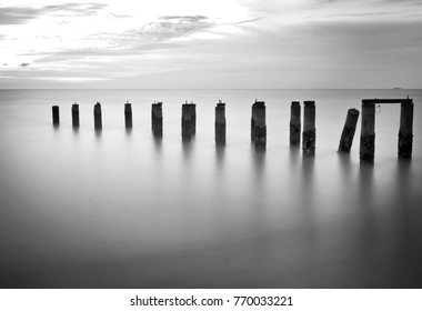 Fine art image in black & white of abandon pier at Butterworth beach, Malaysia. Soft Focus due to long exposure.