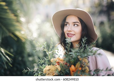Fine art lifestyle Fashion model flowers in park