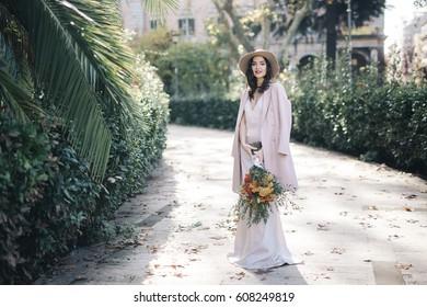 Fine art lifestyle Fashion model flowers in park