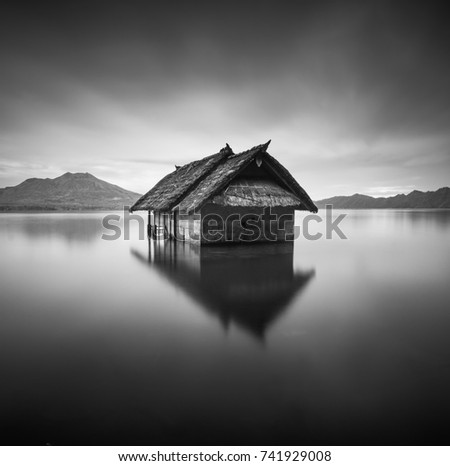 Fine Art Or Minimalist Of A Floating House Waiting To Sink On Lake In Black And