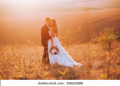 Fine art photo of an attractive wedding couple