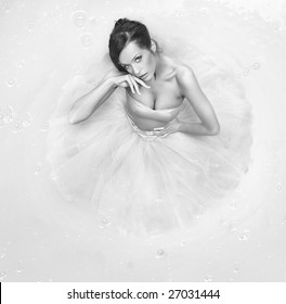 Fine art photo - beautiful girl standing in a big paint container - black white version