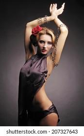 Fine art photo of fashion woman on black background