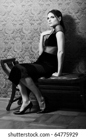 Fine art photo of a fashion woman in a luxurious interior