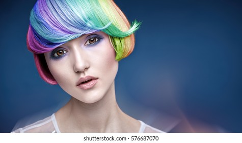 Fine art photo of fashionable beauty with colorful hairstyle