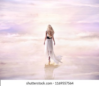 Fine art photo. Young woman walking on clouds
