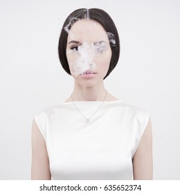 Fine art portrait of a beautiful lady with cigarette smoke
