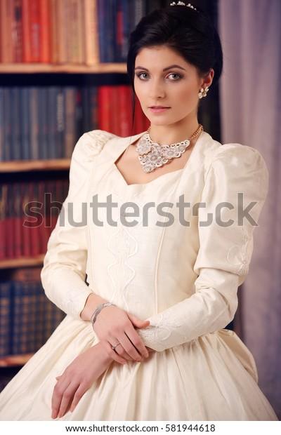 fine art portrait of a bride in vintage dress studio
