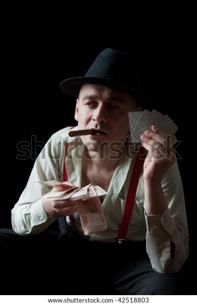 Fine art portrait of man smoking a cigar