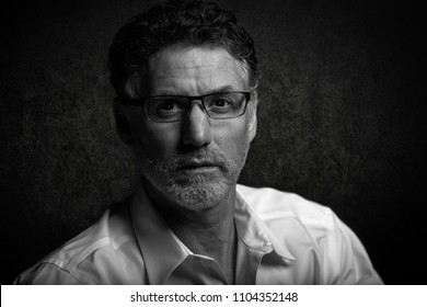 Fine art portrait of a mature man looking at the camera in a serious manner.