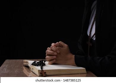 fine art portrait of a novice nun in deep prayer with rosary