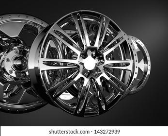 fine chrome car discs on dark background