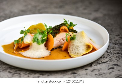 Fine dining Chicken breast with homemade ravioli and vegetables