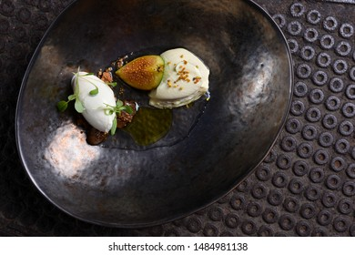 Fine dining dessert, Figs ,caramel ice cream, white chocolate mousse and spices