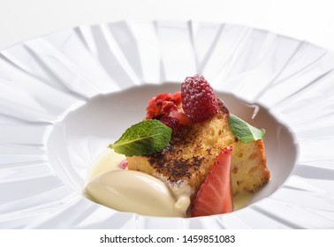 Fine dining dessert, Souffle, Raspberry Parfait, ice cream, white chocolate mousse and spices
