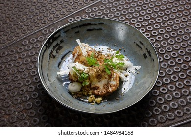 Fine dining, grilled cauliflower with goat cheese and truffles