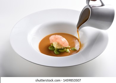 Fine dining, shrimps soup with spices
