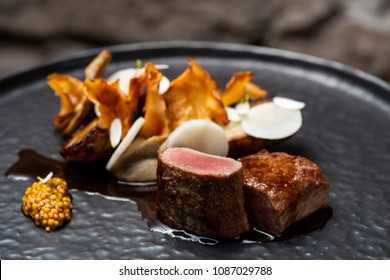 Fine dining Venison Steak with sweet potato and vegetables