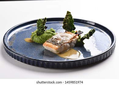 Fine dining, white fish fillet breaded in herbs and spice with asparagus