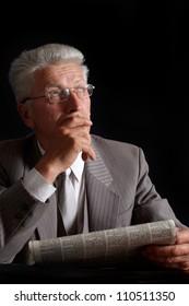 Fine elderly man in suit on black background