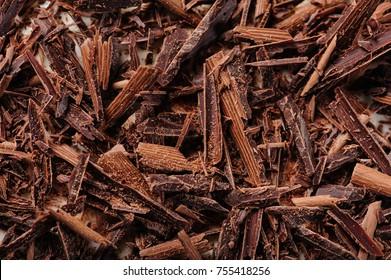 fine grated dark chocolate macro closeup, shallow DOF