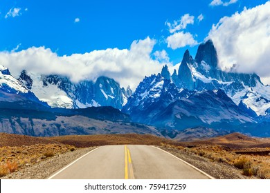 Fine highway to the grandiose Mount Fitz Roy. Argentine Patagonia. The concept of active and extreme tourism. Summer sun and blue sky above the prairie