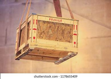 Fine image close-up of fragile symbol on wood board.material label beside the transportation wooden box standard package in the truck