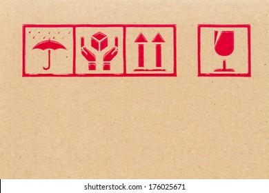Fine image close-up of fragile symbol on cardboard.