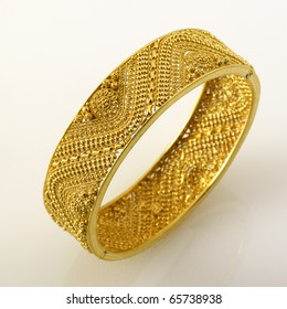 Fine Jewelry gold cuff bracelet isolated on white