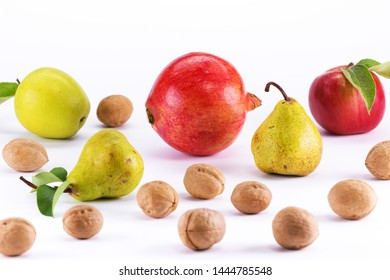 fine juicy ripe fruit with nuts on a white table